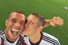 Lukas Podolski's selfie tweet with teammate Bastian Schweinsteiger. Photo /Twitter - @Podolski10