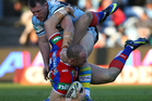 Beau Scott of the Knights is tackled by Paul Gallen. Photo / Getty Images