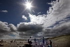 Kids play on Castlecliff beach in March 2013 during Wanganui's hottest year on record. Photo/Stuart Munro
