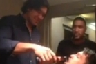 Steven Luatua pours beer down the throat of Josh Stol in a video seen on YouTube.
