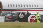 Michael Bloomberg heads for his private jet after less than 24 hours in Queenstown. Photo / James Allen