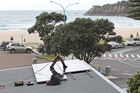 PowerSmart install solar panels at  Mt Maunganui campground last year. Photo / APN