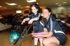 Camp Quality participant Millie (with companion Megan Farr) enjoys the action at Superstrike Tenpin Bowling in Hastings. Photo / Paul Taylor