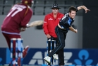 Adam Milne fires a ball to the West Indies during the T20 game on Saturday night. Photo / AFP