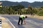 Police mark out skid marks on Clifton Rd yesterday. Photo / Paul Taylor