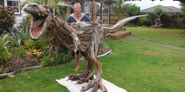 Northland sculptor Greg Maddox shows off Woody, the raptor.