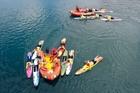 Lifeguards help out at the Bridge to Bridge Swim in Tauranga Harbour on Saturday. Photo/Andrew Warner