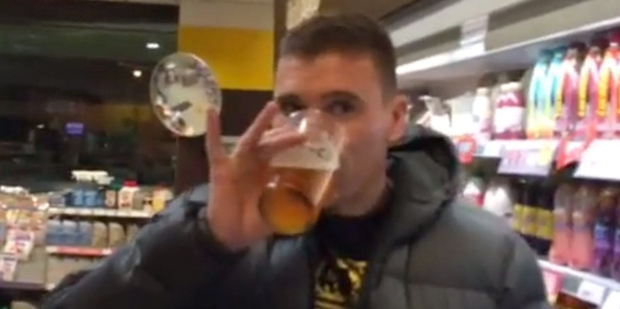 Radio host Dom Harvey drinks a beer as part of the 'neknominate' online trend.