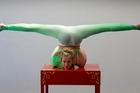 Emma Phillips juggles a wooden table. Photo / Brett Phibbs