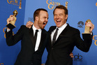Aaron Paul, left, and Bryan Cranston pose in the press room with the award for best television series - drama for Breaking Bad. Photo / AP