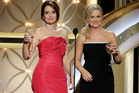 Tina Fey and Amy Poehler host the 71st annual Golden Globe Awards at the Beverly Hilton Hotel. Photo/AP