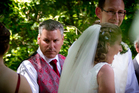 Groomsman Paul Wilson (left) with newly married couple David Bain and Liz Davies after their wedding ceremony at Trent's Vineyard in Christchurch this afternoon. Photo / Sarah Ivey