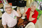 Margaret Sinnett and Lois Whiting with a cup won by Mrs Whiting's grandfather in 1918 for the best two pigs for suitable bacon purposes. Photo / Ruth Keber
