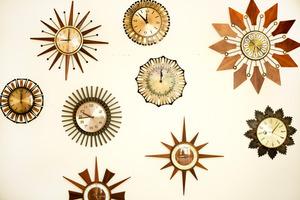 Teresa's starburst clock collection. Photo / Babiche Martens