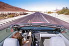The vast, varied landscapes, small towns and big cities that fly-drivers pass through make the practical matters of driving on the right and learning a few new laws well worth it. Photo / Getty Images