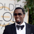 Sean Combs arrives at the 71st annual Golden Globe Awards. Photo / AP