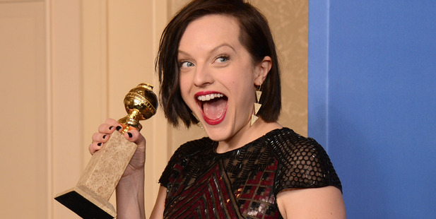Elisabeth Moss poses with the award for best actress in a mini-series for 'Top of the Lake' at the 71st annual Golden Globes. Photo / AP