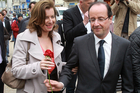 2012 file photo of Francois Hollande offering a rose to his companion Valerie Trierweiler, who's been hospitalised after his affair revelations. Photo / AP
