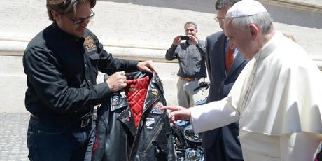 Pope Francis receives a leather jacket from Harley Davidson Motor Company senior vice-president Mark Hans-Richer. Photo / Supplied