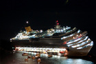 The Costa Concordia lays on its starboard side after it ran aground off the coast of the Giglio island, Italy. Photo / AP