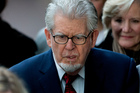Australian-born veteran entertainer Rolf Harris leaves after his hearing at Southwark Crown Court in London. Photo / AP