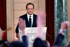 Reporters raise their hands during French President Francois Hollande's annual news conference. Photo / AP