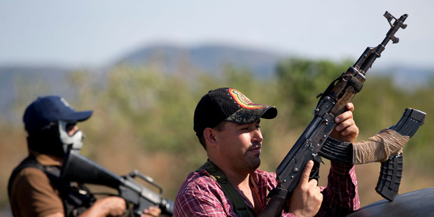 Armed men belonging to the Self-Defense Council of Michoacan. Photo / AP