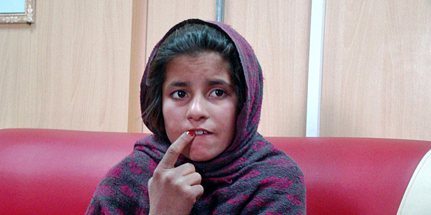 Spozhmai, 10, is held in a border police station in the Khan Neshin district. Photo / AP
