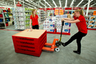 Staff members stock the new Warehouse store that is opened in Royal Oak in Auckland. Photograph by Dean Purcell.