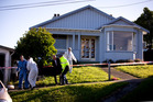 The body of Edward Livingstone is brought out of the house on Kiwi Street in Dunedin. Photo / Dean Purcell