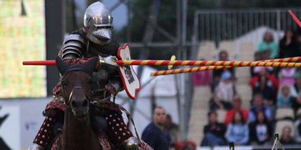 A jousting knight from the Order of the Boar.