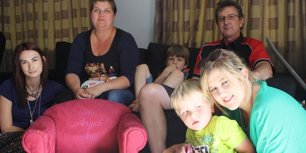 Shelley (back left) and Adam Muir want to take their sons Nico (on the sofa) and Asher to Disneyland while Shelley is still able to travel. Also pictured are Nico and Ahser's step sisters, Ashleigh (left) and Brooke Muir (right). The pink chair in the foreground was intended for Arie - Shelley and Adam's daughter who was stillborn.
