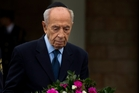 Shimon Peres places a wreath next to Ariel Sharon's coffin outside the Knesset yesterday. Photo / AP