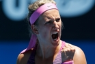 Victoria Azarenka planned an ice bath after her 7-6 (2), 6-2 victory against Johanna Larsson. Photo / AP