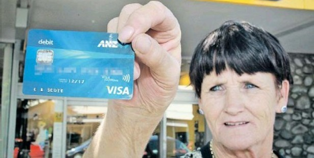 TIMELY REMINDER: Cherie Scott's mother, Carol Johnson, holds an ANZ debit card which someone stole and used to take $170 from an ASB Bank ATMon Middle Road. Footage was wiped after 28 days and police did not catch the offender, highlighting a need for vigilance when using money machines.