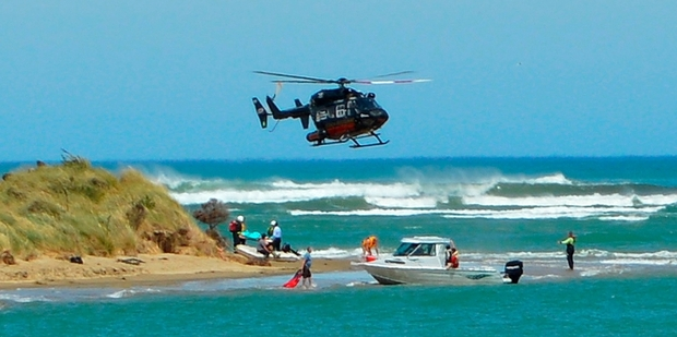 A rescue helicopter joined in the search for the teenager, who was found on the shore half an hour after her boat capsized in rough seas. Photo / Otago Daily Times