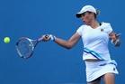 Marina Erakovic struggles in the 41C temperatures. Photo / Getty Images