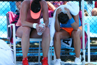 Eva Hrdinova of the Czech Republic and Paula Ormaechea of Argentina feel the heat in their first round doubles match. Photo / Getty