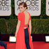Emma Watson's pick of pants with backless dress is risky, but we reckon she owns it, and the online fashion community seems to be in love. Photo / AP