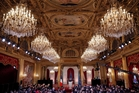 About 500 reporters turned up to Francois Hollande's press conference in the gilded grandeur of the Elysee Palace banqueting hall. Photo / AP
