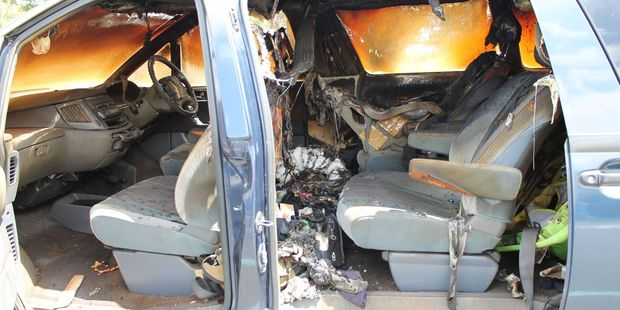 The interior of the car was gutted by the flames. Photo / Manawatu Guardian