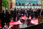 Uh-oh - who left that there? Staff clean up water on the red carpet of the Golden Globe awards in Beverly Hills. Photo / AFP