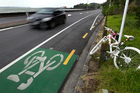 A bike painted white is parked opposite the section of road on Tamaki Drive where 27-year-old Jane Bishop died in 2010. Photo / Dean Purcell