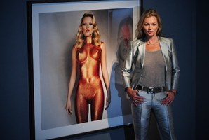 Kate Moss poses next to a photograph entitled 'Body Armour' by Allen Jones. Photo / Getty