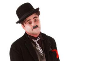 Charlie Chaplin, aka Paul Romhany.