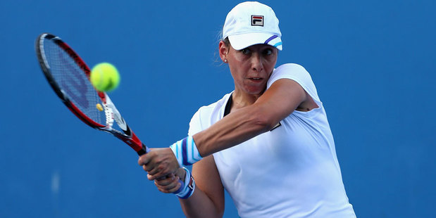 Marina Erakovic plays a backhand in her first round match against Sorana Cirstea of Romania during day two of the 2014 Australian Open. Photo / Getty Images