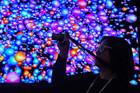 A trade show attendee shoots video of an LG Ultra HD 3D wall display. Photo / AP