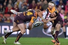 The Broncos' defence put a stop to Ben Matulino of the Warriors during the clash at Suncorp Stadium in Brisbane on Saturday night.  Photo / Getty Images