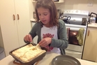 Lucy cutting her bacon and egg pie.