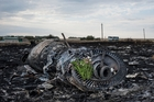 Flowers have been placed on one of the Boeing's mangled engines near the village of Grabovo. Photo / AP